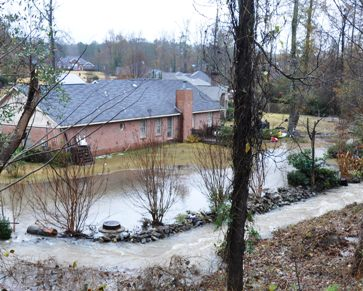 Flooding can occur with houses built on the bottom of a hill such as this example.  Common drainage problems loften need the expert advice of Atlanta Civil Engineering.